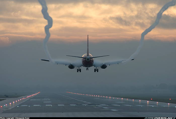 An aerodynamic contrail on a landing jet