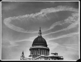 ca. August 1944, London, England, UK --- Vapour trails left by British bombers on route to attack flying-bomb sites encircle the dome of St. Paul's Cathedral. London, 1944. --- Image by © Hulton-Deutsch Collection/CORBIS